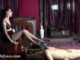 Domme Shoves Her Feet Into Mouth Of Gagging Naked male slave