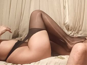 Wife gives footjob in stockings, big feet