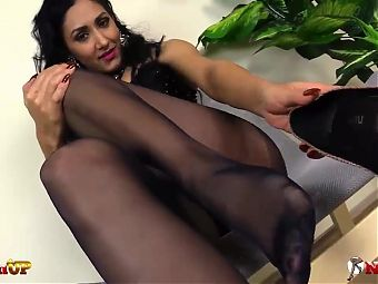 Mistress Alexya in pantyhose gives you a footjob
