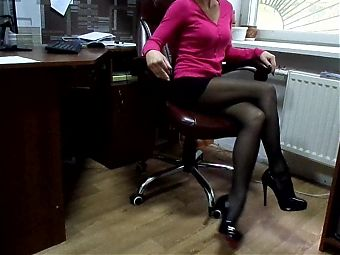 Secretary Karina at the office in the bosss leather chair