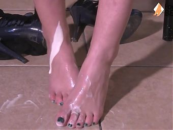 Sexy barefoot redhead puts yogurt cream on her feet