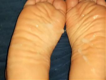 Cumshot on sexy wrinkled soles